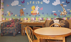 table and chairs with puzzle, and stuffed animals